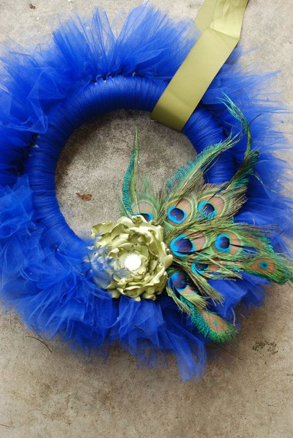 Prissy Peacock Tu-Tu tulle wreath- royal blue with green silk flower. I never hang wreaths, but this is an interesting one.