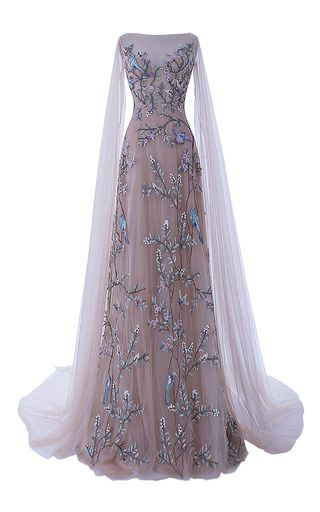 This **Hamda Al Fahim** gown features layered tulle with full embroidery of leaves and birds with a boat neckline, sheer tulle open sleeves and a bias insertion at the back.