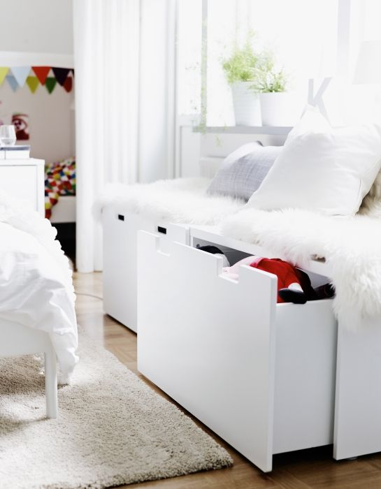 Place a STUVA bench (or two!) beneath your bedroom window for a convenient place to sit and get ready in the morning or at night. The bench can be made cozy with cushions on top and has convenient storage underneath for extra pillows, bedding, or clothes.