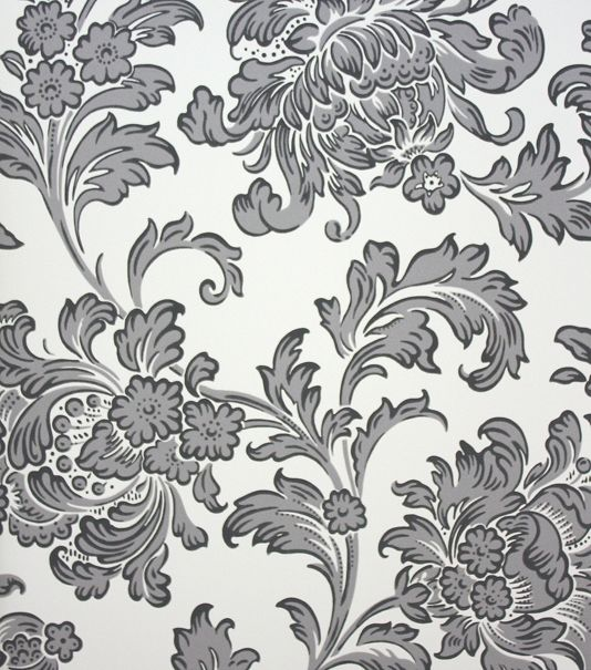 North End Road Wallpaper A relaxed scrolling floral wallpaper with plumes of rich foliage on a cream background.
