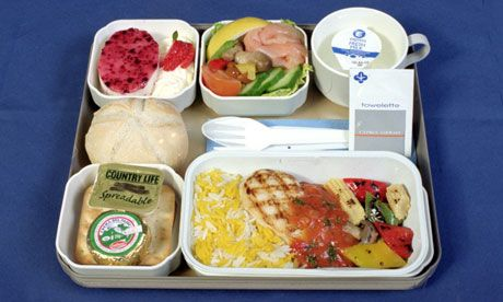 A Cyprus Airways hot meal: smoked salmon with marinated Italian mushrooms, charcoal grilled chicken with a tomato and basil sauce, stir-fried vegetables and saffron pillau rice, raspberry mirror, and cheese and crackers.