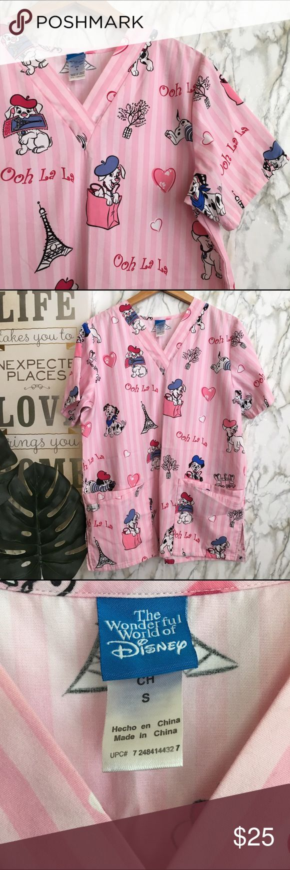 "Nurse Scrup top Disney 101Dalmations,Paris France Super cute DISNEY scrub Top 101 Dalmations Nurse scrub Top. Look like new, 2 pockets, short sleeve, size S. No stains, No Holes, No smoking Home 🏡 bought originally from Disney store, looks like new. Dimensions: arm pit to arm pit 20"" & top to bottom 28""🎀shipped same day if you buy it before 3pm 🐝🌸🌼🌸 Disney Tops Tees - Short Sleeve"