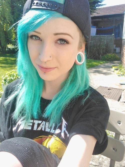 skinny emo teen with tattoos piercings and dyed hair