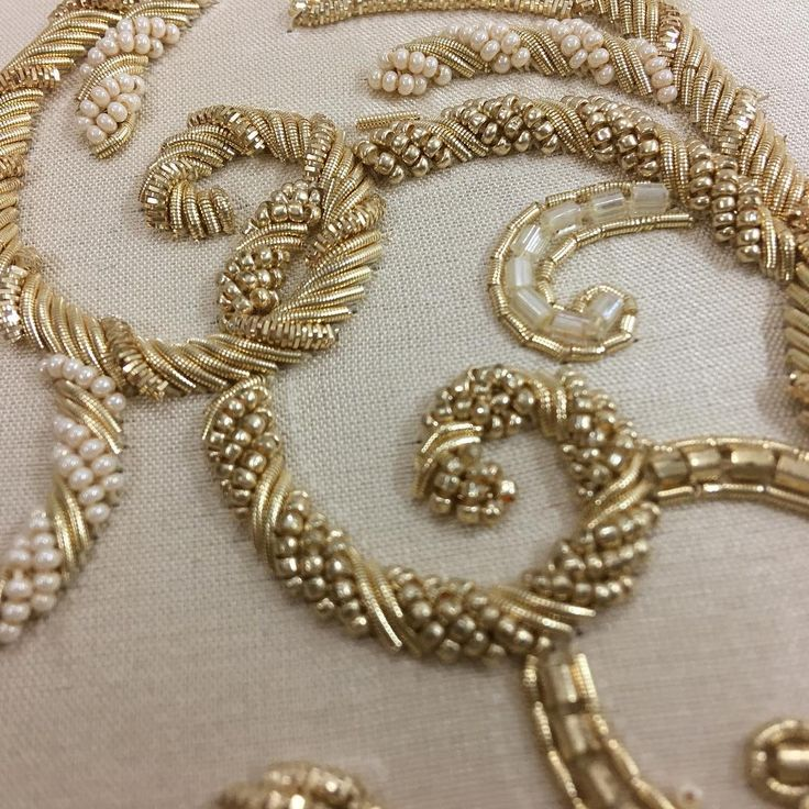 Golden swirls... and on this note, hello to a happy Eid and long weekend for all the hard working and talented embroiders we are lucky to have working at the studio  #thankful #gratitude #craftsmanship #handembroidery #embroidery #design #tambour #beading #couture #fashion #bridal #hautecouture #gold #goldwork #madewithlove