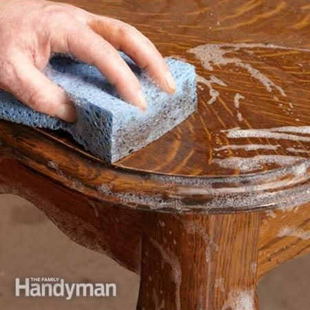 A thorough cleaning is an important first step in any furniture renewal project. Removing decades of dirt and grime often restores much of the original luster. Kevin says it's hard to believe, but it's perfectly OK to wash furniture with soap and water. Kevin recommends liquid Ivory dish soap mixed with water. Mix in the same proportion you would to wash dishes. Dip a sponge into the solution, wring it out, and use it to gently scrub the surface.