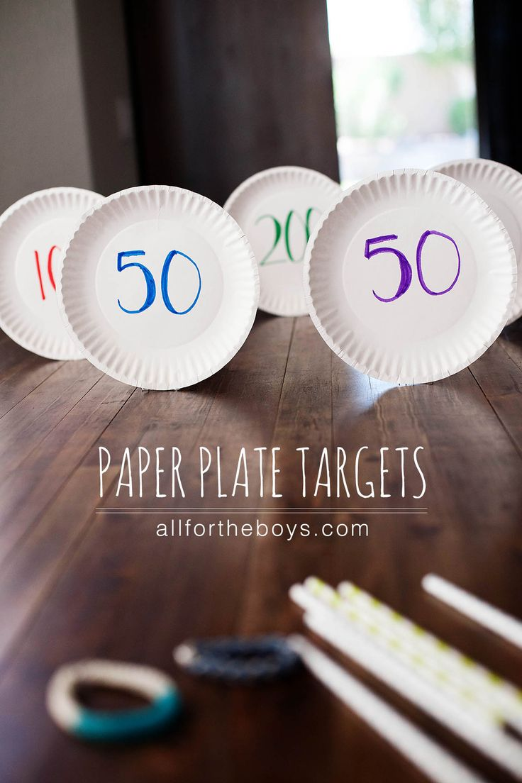Paper plate targets and rubber band bracelet bow and arrow