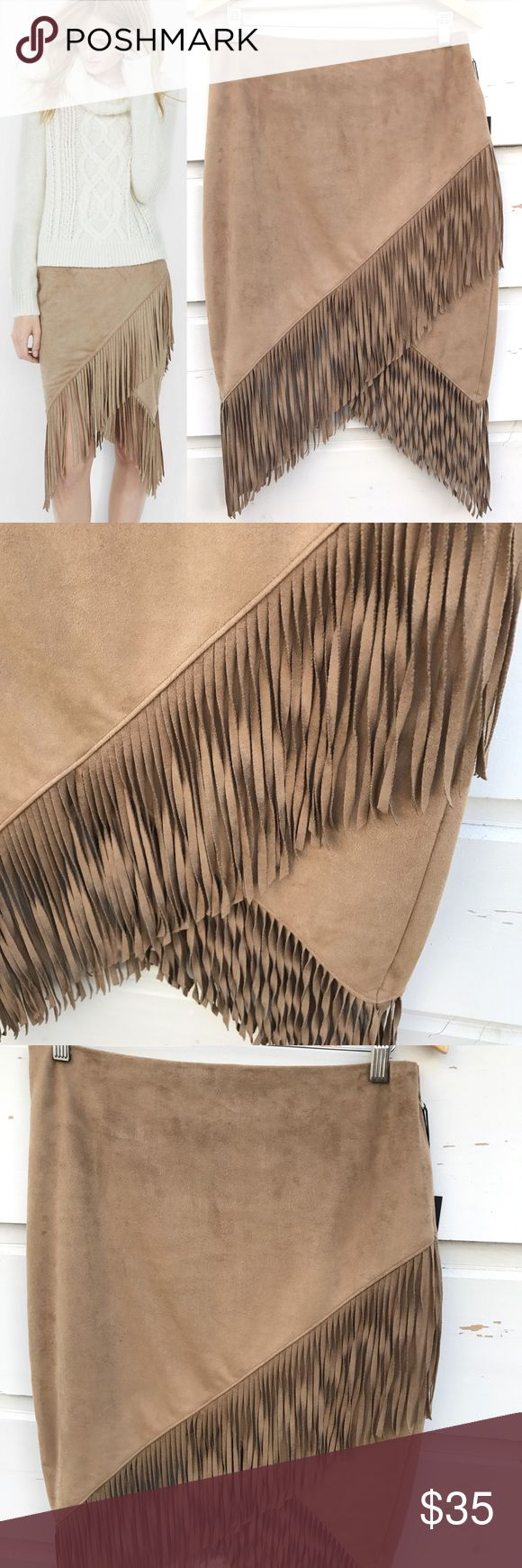 """EXPRESS faux suede fringe skirt EXPRESS faux suede fringe skirt. A supple, faux suede wrap skirt with ample, eight-inch fringe that swishes when you walk. Keep it simple and sexy with a shape-skimming ribbed sweater or go for a fully Southwestern vibe with a cami and denim jacket. High waisted Hidden hook and zipper on side 8"""" fringe embellishment Wrap hem; Lined Polyester/Spandex body; Polyester lining Machine wash New with tags. Best offer. Express Skirts"""