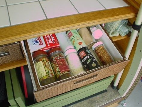 The galley has oak cabinets and a tile counter.  It uses broom handles as hatch supports.  The galley is very simple and water tight...