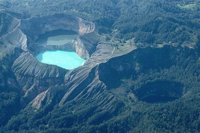 Kelimutu, Flores, Indonesia. Walking up the slopes at night, watching the sunrise over the 3 mineral coloured (ever so colour shifting) craters. Magic!