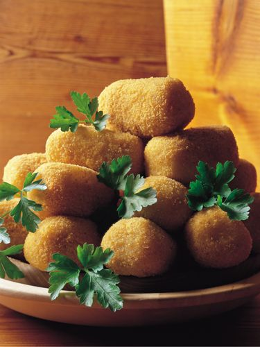 TURN LEFTOVER MASHED POTATOES INTO CROQUETTES:  Form cold mashed potatoes into little balls, dip in beaten egg, coat in bread crumbs, and sauté or deep-fry. You can also mix in crabmeat or salmon.