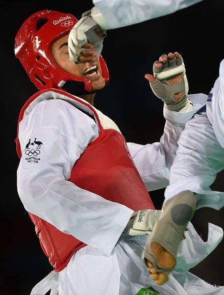 Great Britain's Lutalo Muhammad competes against Australia's Hayder Shkara…