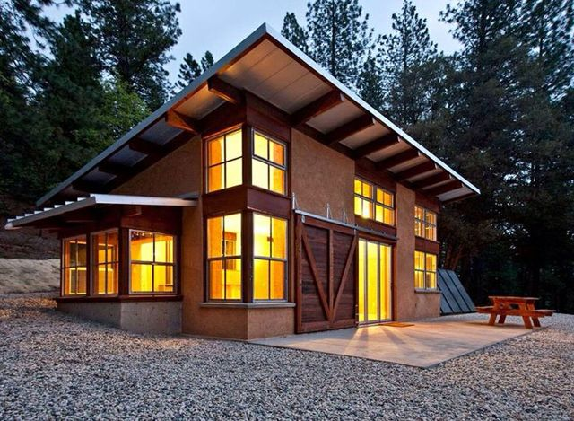 This modern timber frame cottage offers a unique blend of for Simple timber frame homes
