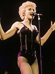 Madonna was queen of the underwear as outerwear phenomenon in the 80's. Bustiers, underwear shaped pieces, and corsets are a few of the items that could be attached to pieces of clothing. Madonna wore many underwear as outerwear pieces by Jean Paul Gaultier.