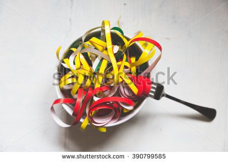 a bowl with many colored strands of paper, abstract concept for spaghetti - stock photo