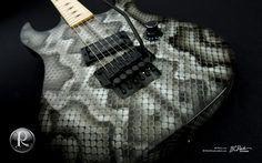 BC Rich Gunslinger w/ snakeskin graphics + embedded digital tuner.