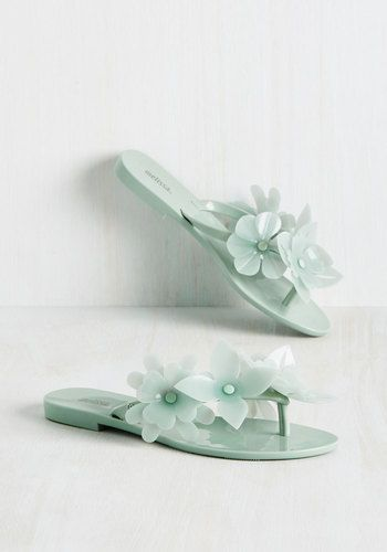 Building bouquets brings you bliss, and even when you're not hard at work, you have these misty blue flip flops from Melissa Shoes to rep your passion! This recyclable, vegan pair flaunts flower appliques atop its flip-flop straps, and you have plans to flaunt 'em as often as possible.