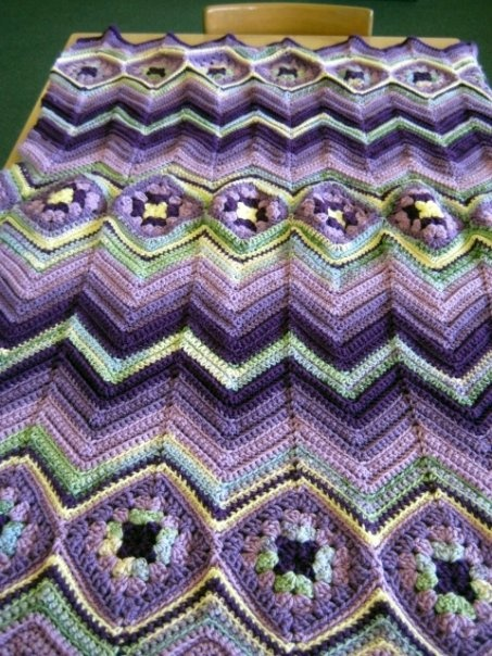 wow!  Crochet Soirée on FB  Love connecting granny squares on angle and adding chevrons