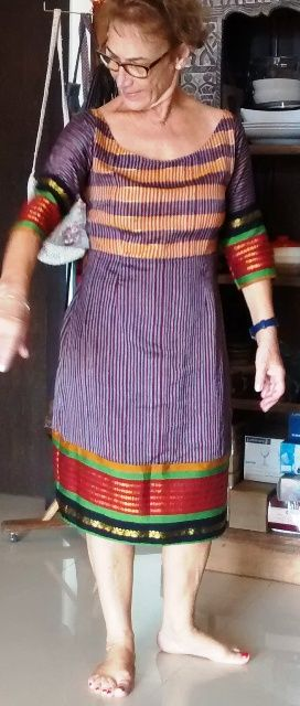 A beautiful soft cotton saree with vibrant coloured border. made a fitting dress, semi formal,using the saree border at the hemline and 3/4 th.sleeves. Pallu part of the saree went on the bodice. Wide neck was ideal choice for this dress