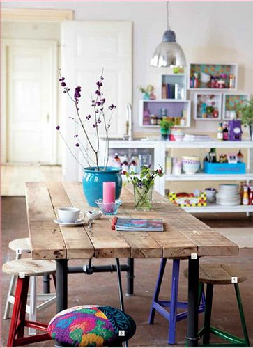 I like the idea of having a kitchen area that has round stools at it. Something a little more refined like this would be great in a eating nook