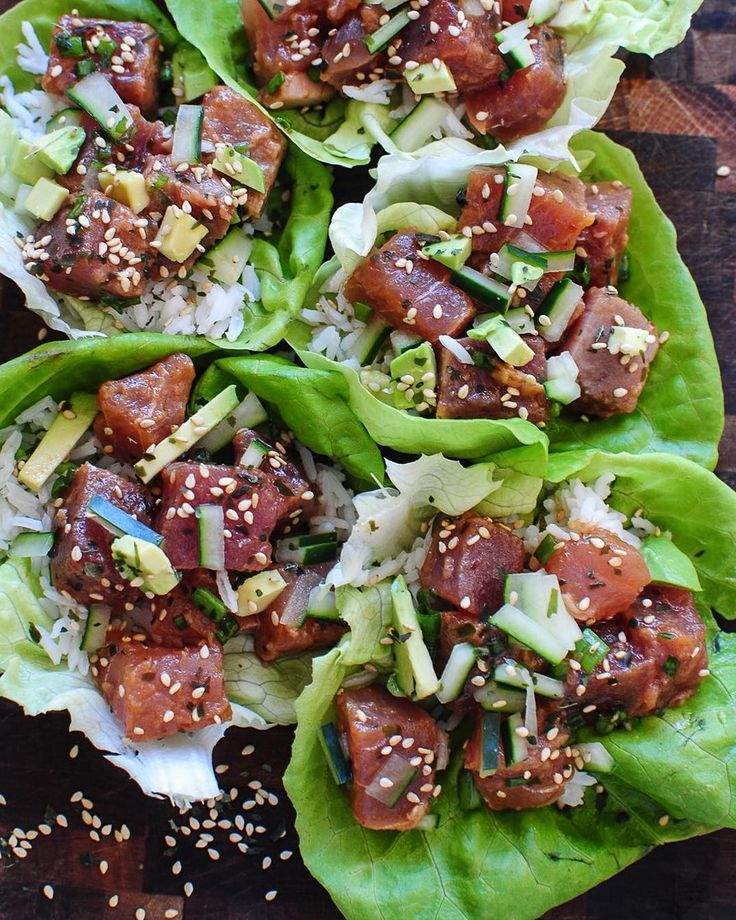 SPICY TUNA POKE LETTUCE WRAPS Made by @bevcooks . Another amazing foodie to follow. @bevcooks. Also checkout her blog  INGREDIENTS 1 pound sushi-grade ahi or yellowfin tuna 1 Tbs. soy sauce 1 Tbs. sesame oil 1 tsp Sriracha sauce (or sambal oelek) juice from half a lime (plus more wedges for serving) 1 tsp brown sugar 1/2 avocado diced 1/2 cucumber seeded and diced 2 scallions finely sliced 1 head butter lettuce rinsed and leaves separated 1 cup cooked white rice sesame seeds for garnish…