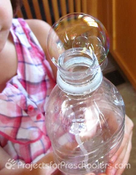 Blowing bubbles with a plastic bottle= great boredom buster