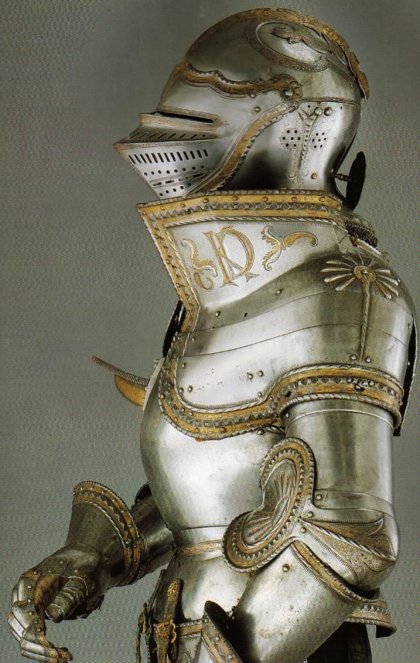 gilded plate armor with armet helmet weapons armor