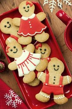 Gingerbread Man Christmas Cookies!  I've included a TOP RATED Sugar Cookie recipe!  This recipe holds the cookie shape even when you bake it!  It tastes amazing too!