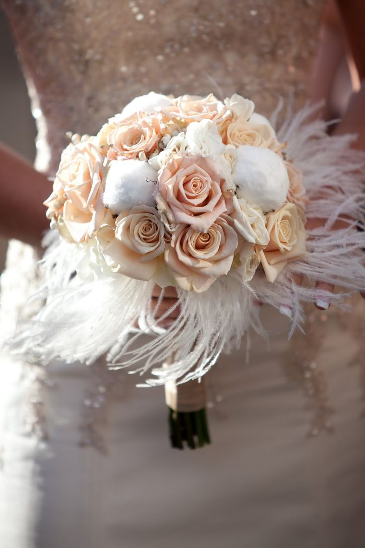 Saint Louis Bride Magazine: Bouquet Of The Week #feathers #roses