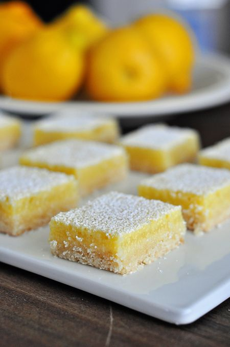 Lemon Bar recipe from Mel's Kitchen Cafe. I've been looking for another recipe and this one is fantastic- buttery shortbread and sweet tart lemon curd.