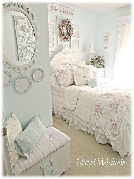 Pale wash of wall color...sign above bed...plates under mirror