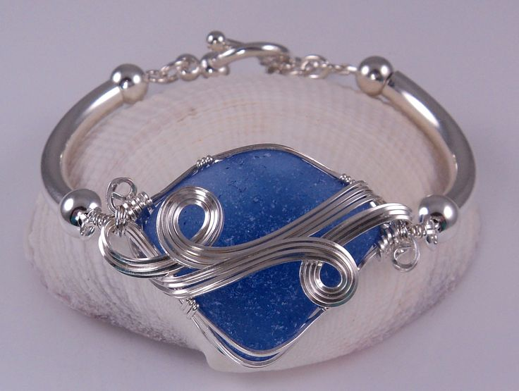 sea glass jewelry ~ I love that color of blue! Beautiful wire wrapping too...