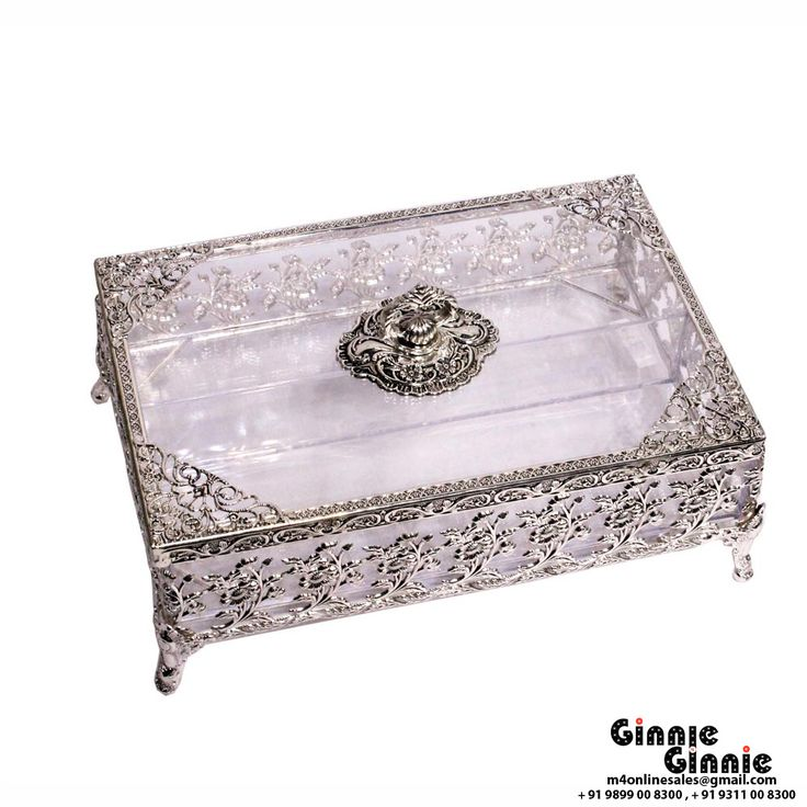 This Ginnie & Ginnie Exclusive Gift Box Flower is a product from our Kitchen & Dinning Improvement Collection. It is made of Alloy and it got Silver Lacquer Coating finish on it. Its approx LxWxH is 10x7x4.5 inches. It is of approx 730 grams. Unique Code of this product is M400399.10