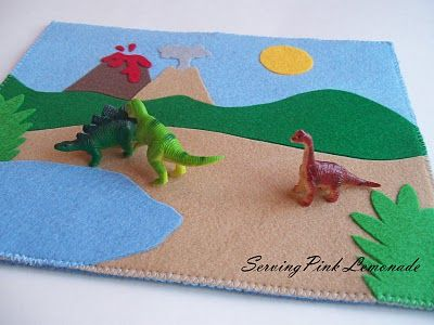 Dinosaur felt play mat. Roll it up and take it to go!!! This blog is in my top 3 favorite!  I did a paper version for the kids 3 ring binder/dry erase quiet book. Will do a felt version soon! Its cute!!!