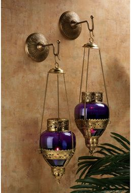 Moroccan Hanging lanterns on a Terracotta wall.