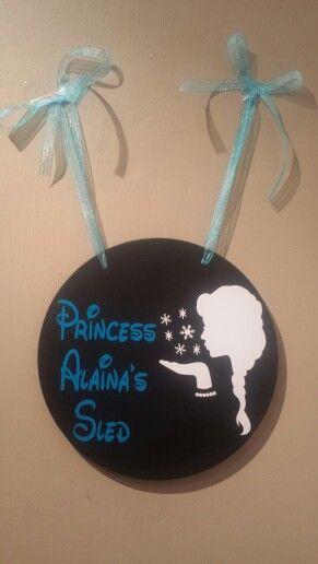 Frozen Elsa stroller sign for an upcoming Disney World trip.   **Ribbon matches sign but due to lighting it doesn't appear that way in the photo