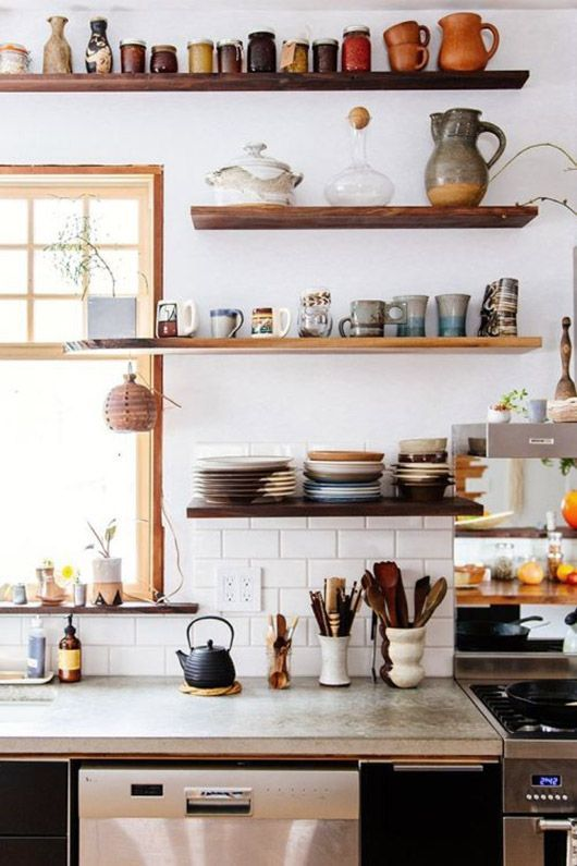 ceramic dishes on open wood shelves in kitchen. / sfgirlbybay