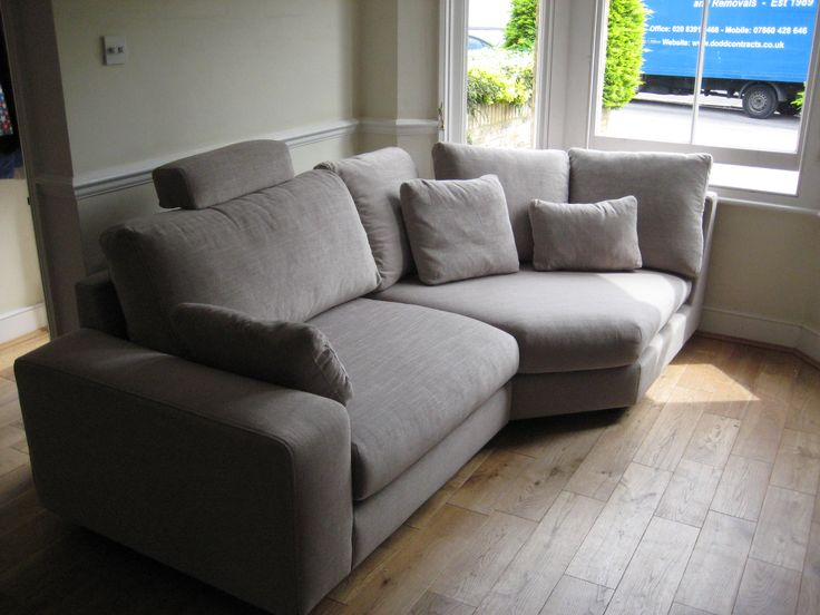 A Small Room With A Bay Window Takes A Large Sofa Section