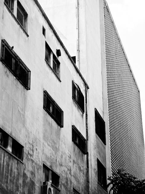 Two Buildings constructed in different periods 1935 & 1965 in creative conflict