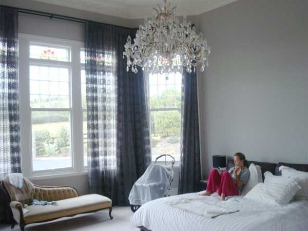 Resene Truffle on bedroom walls, with trims in Resene Black White, and Dark blue/Grey sheer curtains