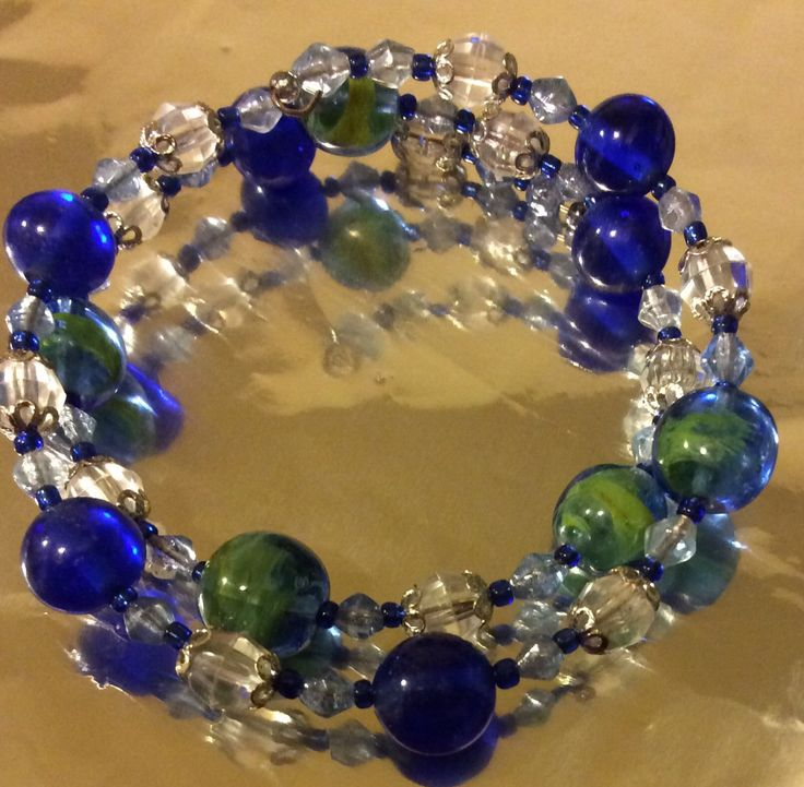 Beautiful Glass Bead Memory Wire Bracelet with imported Blue Green marble beads by AliceAndBettyDesigns on Etsy