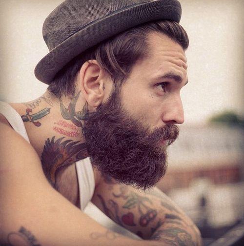 Tattoo and beard.