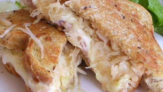 Heating the sauerkraut and turkey before assembling the sandwiches ensures that the filling is warmed through in this indulgent meal.