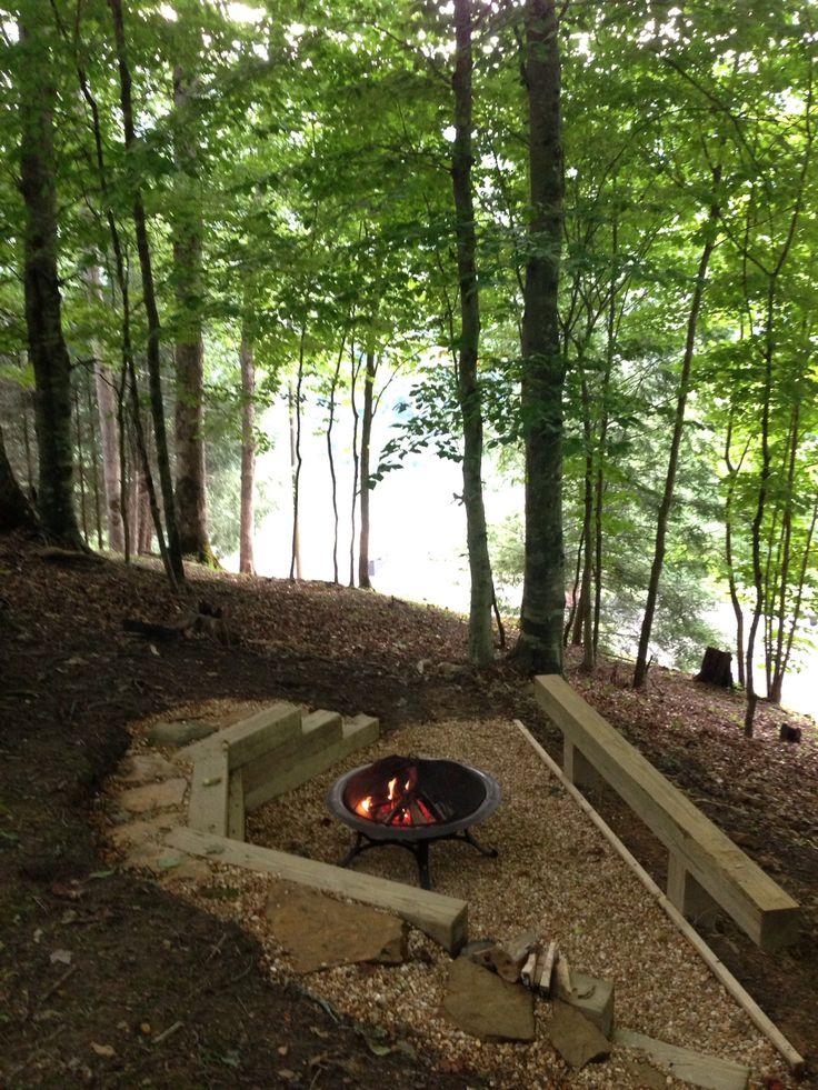 DIY backyard fire pit overlooking lake