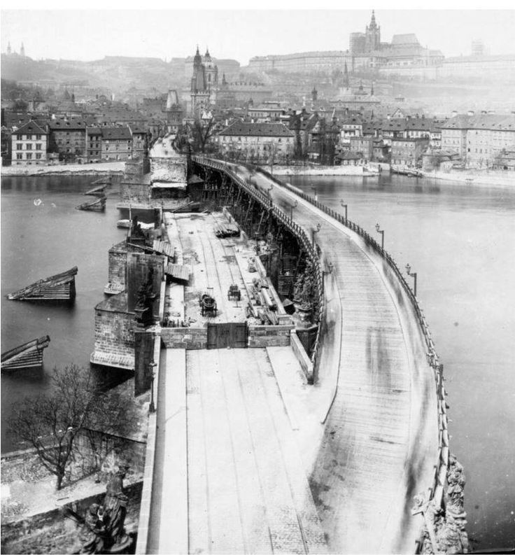 Charles bridge was partially destroyed by flood in 1890. There was built a temporary wooden bridge near the missing part.