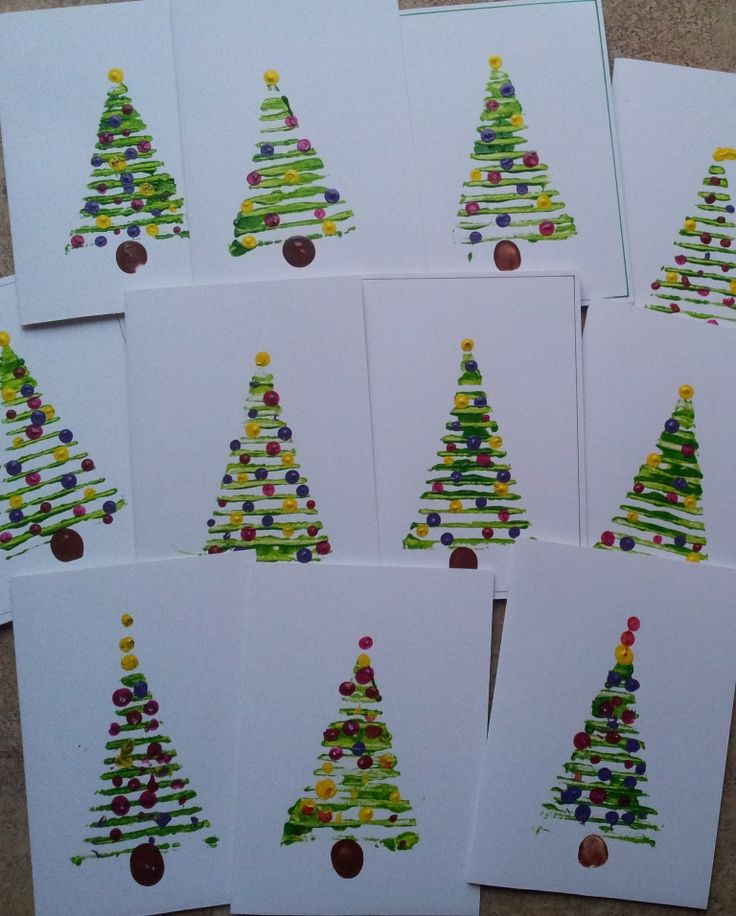 Christmas Cards. To make them we pulled the top layer off a piece of cardboard, cut out some triangle shapes and after putting on some green paint, we printed some small Christm...