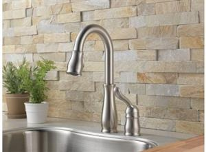 natural stone backsplash - will look great in the kitchen.