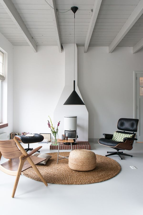 White, black and natural tones in the sitting room of the fabulous studio of interior designer Christien Starkenburg.