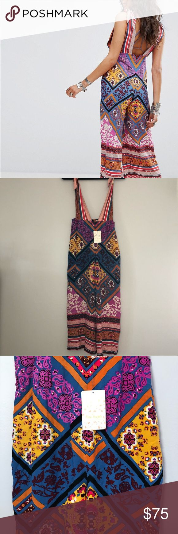 "NWT Free People Maritzah Multi-colored Jumper Sz 0 New with Tags! Gorgeous multicolored jumper. Size 0. Measurements are approximate: 16"" at top, which is adjustable with shoulder ties. 14"" from top of pant to crotch 22"" inseam 13"" across waist 18""across hips. #mc012 Free People Pants Jumpsuits & Rompers"