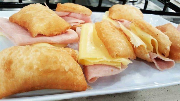 Pan inflado frito italiano relleno con jamón y queso