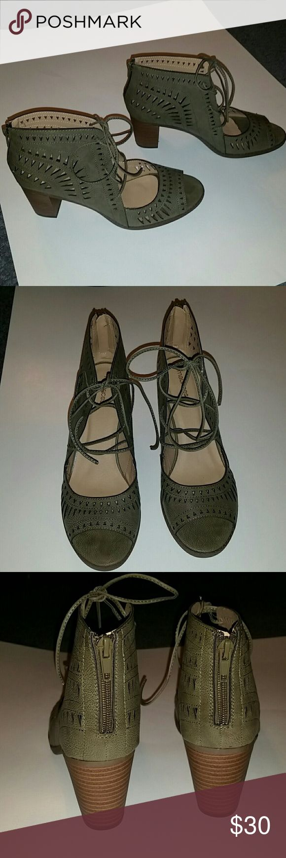 Maurices Green Lace Up Heeled Booties Size 11M These gorgeous shoes are by Maurices. They are brand new, never been worn. They are in great condition no marks or flaws. Size 11M. Color is Green and it has a cut out design. Lace up. Has a heel. Also, there is a zipper in back. If you have any questions please let me know. Feel free to make an offer! Maurices Shoes Ankle Boots & Booties